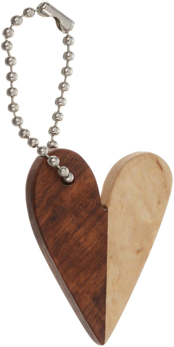 Брелок Сердце, 4,5 х 3 см. Ручная работа. Автор Дмитрий ШульцБрелок для сумкиБрелок ручной работы Сердце изготовлен из натурального дерева. Изделие выполнено в виде сердечка с цепочкой для подвешивания. Такое оригинальное украшение - это блестящее завершение вашего неповторимого, смелого образа и отличный подарок любителю стильных вещиц! Ручная работа. Автор Дмитрий Шульц.Просим обратить ваше внимание на то, что работа, выполненная на заказ, может незначительно отличаться от представленной на фото, так как это авторская работа.