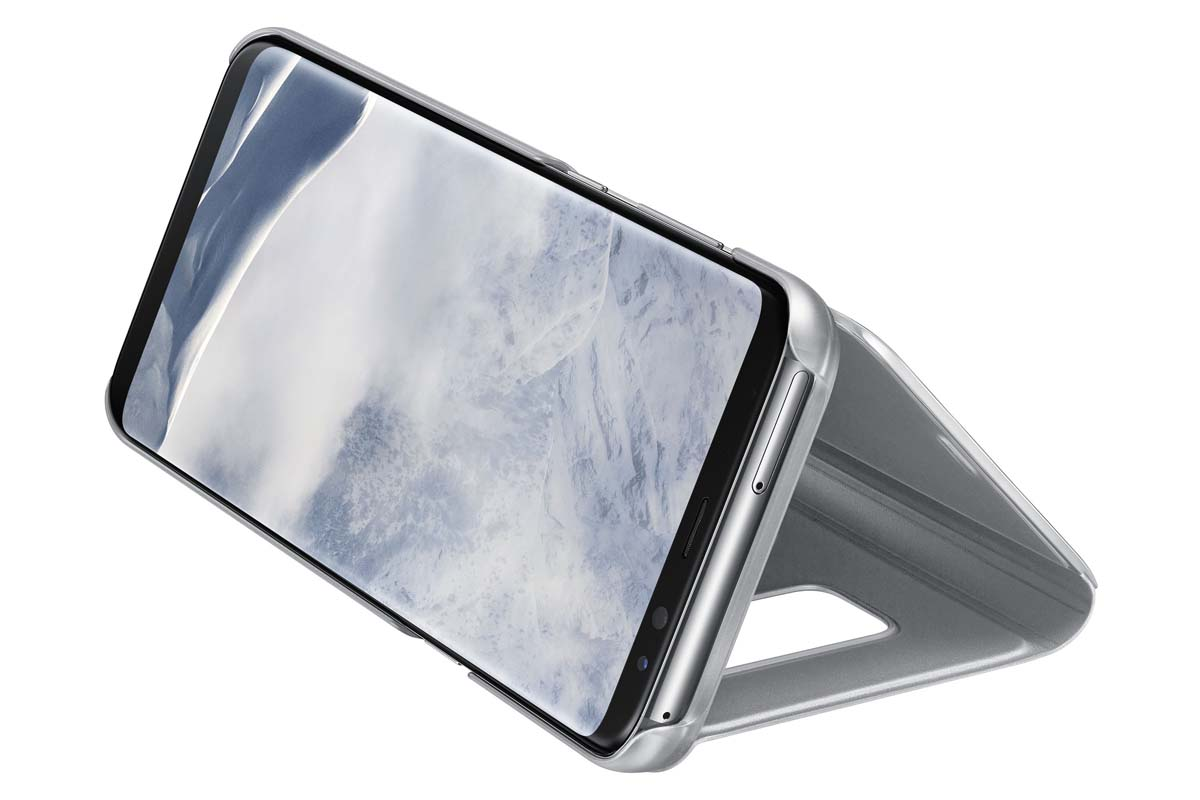 Samsung Clear View Standing чехол для Galaxy S8+, SilverEF-ZG955CSEGRUТонкий полупрозрачный чехол подчеркивает стиль иизящество смартфона. Аксессуар обеспечивает быстрый доступ кфункциям— следите заинформацией наэкране, неоткрывая чехла. Сквозь прозрачную верхнюю крышку видны время, пропущенные вызовы, индикатор заряда. Флип-кейс отзывчиво реагирует наприкосновения— отвечайте назвонки одним легким движением. Чехол устойчив кпоявлению отпечатков пальцев— ваш смартфон всегда ваккуратном состоянии. Особое покрытие чехла защищает смартфон отповреждений, продлевая срок его службы.
