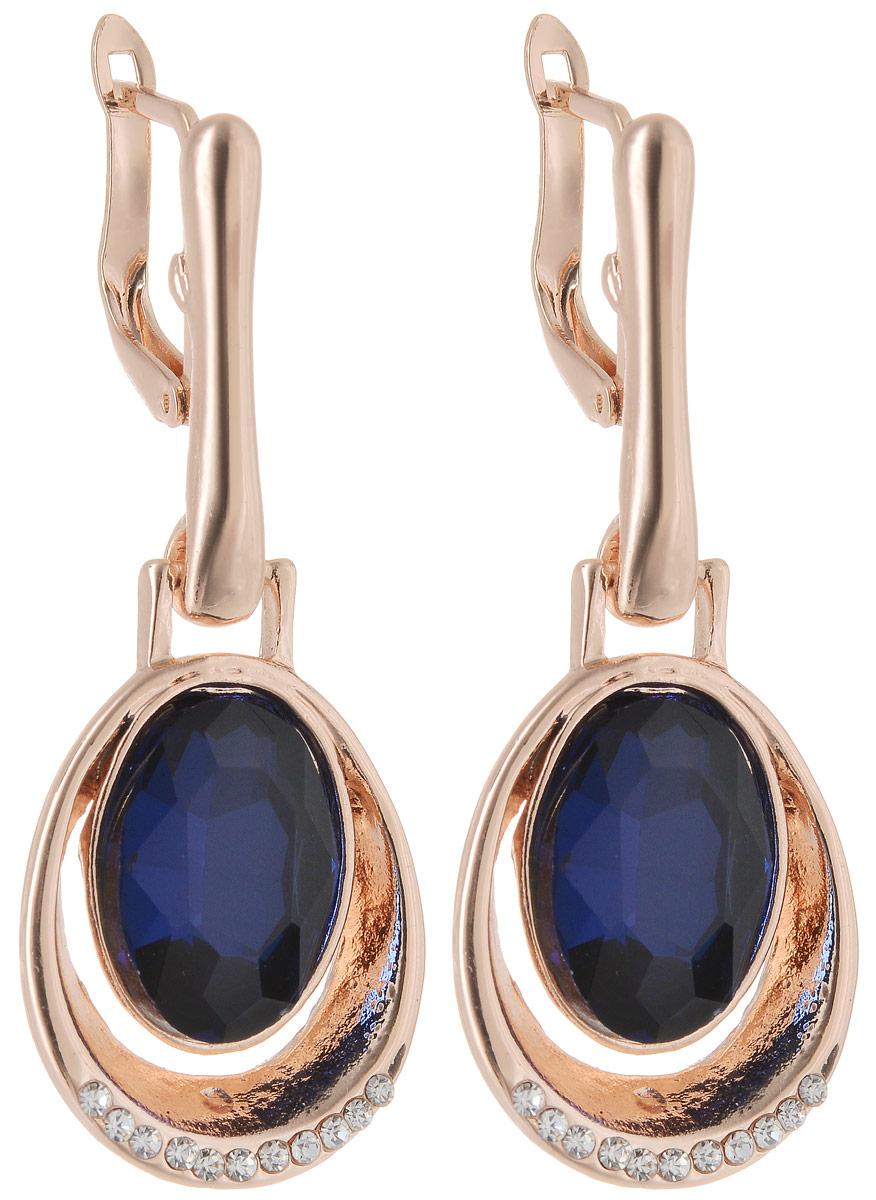 Серьги Taya, цвет: золотистый, темно-синий. T-B-12745Серьги с подвескамиСерьги Taya застегиваются на английский замок. Сверкающий кристалл обрамлен золоток каймой, нижняя часть которой покрыта стразами.