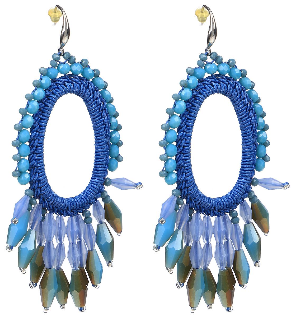 Серьги Taya, цвет: синий. T-B-9559-EARR-BLUE39859|Пуссеты (гвоздики)Серьги с замком-петлей и силиконовой заглушкой изготовлены из гипоаллергенного бижутерного сплава и текстиля. Серьги выполнены в форме овала с окантовкой из камней.