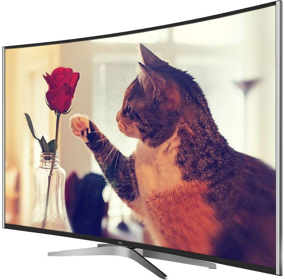 TCL L55C1CUS, Black телевизорL55C1CUSТелевизор TCL L55C1CUS представлен в изогнутом корпусе. Легко впишется в любой интерьер, а специальная возможность крепления телевизора на стену позволит разместить устройство с максимальным удобством. Может похвастаться современным дизайном корпуса и тонкими рамками экрана.Устройство поддерживает современный формат HDR (High Dynamic Range), предназначенный для повышения прорисовки полутонов на экране телевизора и позволяющий максимально приблизить реалистичность телевизионной картинки к оригиналу. Телевизор с HDR создает более привлекательное для глаза изображение, расширяя диапазон передачи цветовых оттенков и позволяя зрителю различать до миллиарда тончайших цветовых тонов. Широкий угол обзора дает также возможность получать отличное качество картинки без искажения.LED телевизор L55C1CUS от TCL позволяет открыть для себя новое качество изображения в формате 4К. Невероятная четкость стала возможной благодаря мощному шестиядерному графическому процессору. Каждый кадр подвергаются тщательному анализу, после чего выполняется улучшение качества отображения текстур, контрастности, цветопередачи и контуров. Детализация изображения при использовании подобных технологий в 4 раза выше, чем у телевизоров Full HD.TCL L55C1CUS поддерживает функцию Motion Estimation and Motion Compensation. Это возможность преобразования частоты кадров видео, позволяющая видеть действие на экране более плавным, чётким и реалистичным. Технология позволяет видеть самые мелкие детали изображения, даже в том случае, когда объекты на экране движутся молниеносно.Оптимизация звука и изображения дает возможность в полной мере наслаждаться просмотром динамичных фильмов или спортивных соревнований, обеспечивая полный эффект присутствия.Smart-телевизор откроет для своих обладателей новый мир увлекательных и полезных функций, которые разнообразят жизнь пользователей и превратят устройство в настоящего друга и персонального помощника. Телевизор оснащен операционной сист