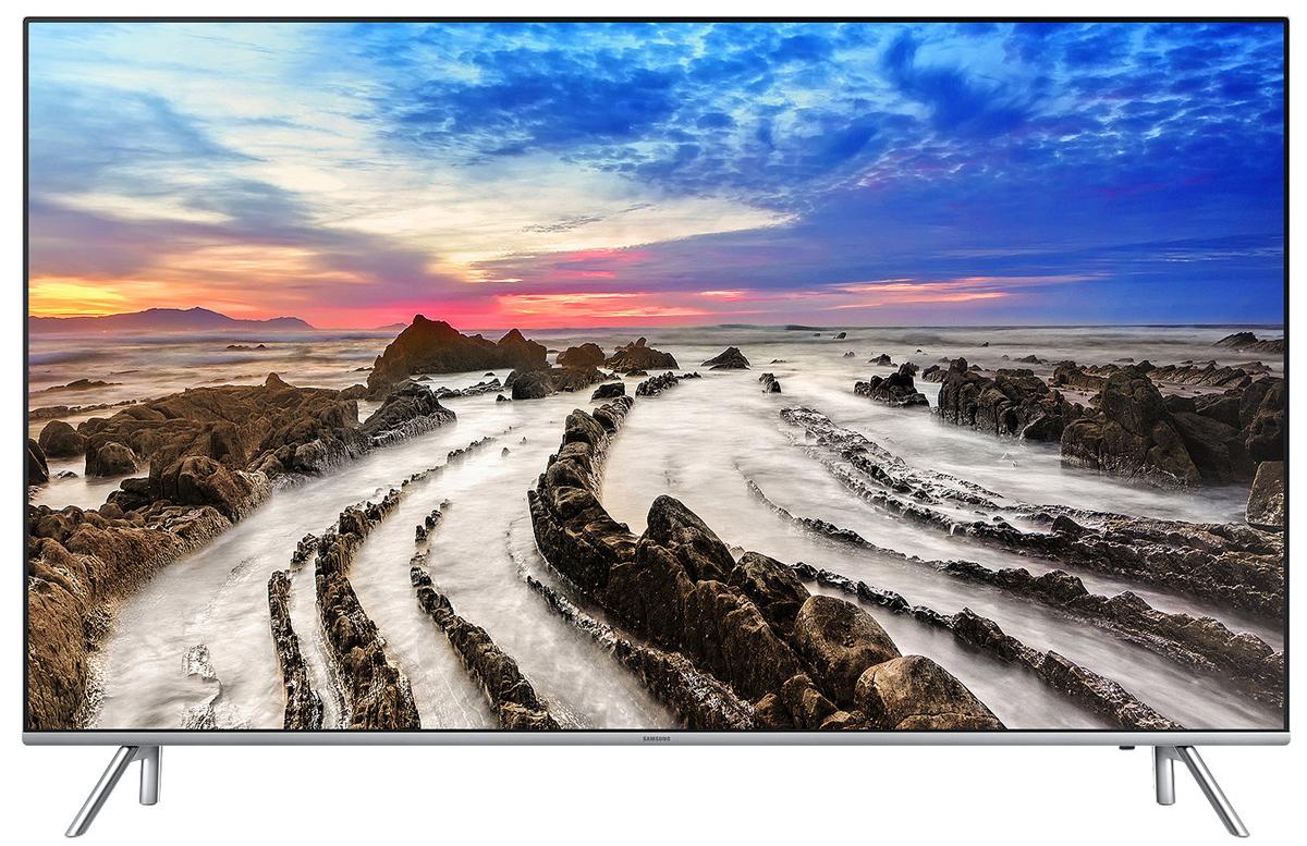 Samsung UE55MU7000 телевизорUE55MU7000UXRUСовершенство с любой стороны. Независимо от того, выключен или включен телевизор Samsung UE55MU7000, перед вами изысканный предмет интерьера с ультратонкой рамкой и гладкой задней панелью.Оцените яркость и четкость изображения с технологией расширения динамического диапазона (High Dynamic Range). Насладитесь четкостью передачи мельчайших деталей и яркостью каждой сцены на экране.Оцените реалистичность, кристальную чистоту красок и динамичность изображения на экране. Будьте готовы удивляться.Оцените высокую четкость отображения динамичных сцен без малейших следов размытия объектов. Благодаря технологии Motion Rate 240, спортивные передачи и контент в жанре action создадут у вас впечатление реальности происходящего на экране.Оцените глубокую проработку деталей в самых темных и светлых сценах с помощью технологии Precision Black. Технологии увеличении контрастности и локального затемнения фрагментов изображения улучшают четкость и точность передачи мельчайших деталей изображения на экране.Технология Peak Illuminator улучшает видимость деталей в темных сценах. Оцените удивительное улучшение качества изображения в любых сценах на экране.Забудьте о запутанных кабелях за задней стенкой телевизора. Подключите все внешние устройства к блоку One Connect. Это устранит проблему жгутов кабелей вы получите больше удовольствия от просмотра телепередач.Оцените невероятное ощущения от эффекта полного погружения. Тонкий дизайн и отсутствие рамки с 3 сторон экрана превращает каждую сцену на экране в захватывающее зрелище.Отполированная поверхность задней стенки и тонкий дизайн корпуса телевизора - это абсолютное воплощение минимализма и элегантности.Полный контроль над системой развлечений в ваших руках. Управляйте всеми устройствами, подключенными к телевизору при помощи универсального пульта ДУ. Переключайте каналы голосом.Просто подключите ваше мобильное устройство к телевизору и просматривайте контент на большом экране. С помощью приложени