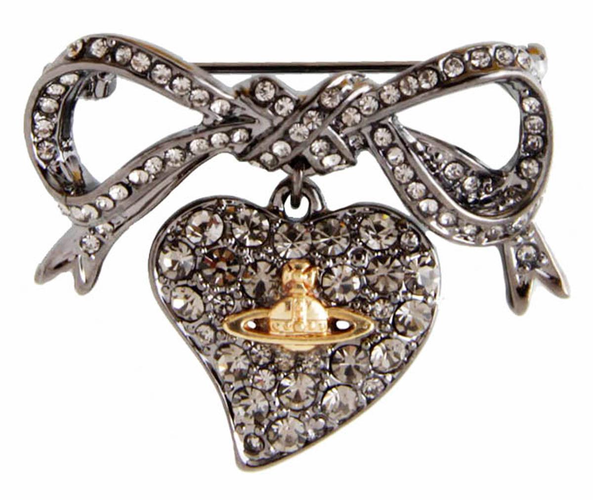 Брошь Сердце в стиле Vivienne Westwood. Бижутерный сплав, кристаллыАжурная брошьБрошь Сердце в стиле Vivienne Westwood. Бижутерный сплав, кристаллы. Размер 3,5 х 3,5 см. Сохранность хорошая. Предмет не был в использовании.Филигранная брошь выполнена из бижутерного сплава серебряного тона.Очаровательная, притягивающая взгляды брошь.Снабжена удобной и надежной застежкой.Брошь - отличное дополнение вашего наряда.