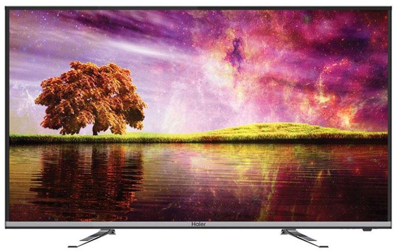 Haier LE40K5000TF телевизор1210668Характерная особенность телевизора Haier LE40K5000TF - тонкий дизайн. Благодаря тонкому корпусу он легко впишется в интерьер, а 40-дюймовый экран делает его подходящим вариантом для гостиной. Сверхтонкие рамки вокруг экрана создают ощущение, будто граница между реальностью и тем, что происходит на экране, сведена к минимуму. Благодаря этому зрителю будет проще погрузиться в атмосферу фильма или передачи.Телевизор оснащён цифровым тюнером, позволяющим наслаждаться передачами эфирного ТВ в цифровом качестве. Достаточно нажать одну кнопку, чтобы поставить передачу на паузу. При этом просматриваемая передача будет записываться на флешку или внешний жёсткий диск, чтобы владелец мог вернуться к просмотру тогда, когда это будет удобно. Эта функция особенно полезна в тех случаях, когда к владельцу телевизора пришли гости или же ему звонят по телефону.Разъёмы USB и HDMI позволяют подключить к телевизору DVD-плеер или камеру, флешку или жёсткий диск, ноутбук и другие устройства. Владелец может смотреть на большом экране мультимедийный контент, записанный на этих устройствах.