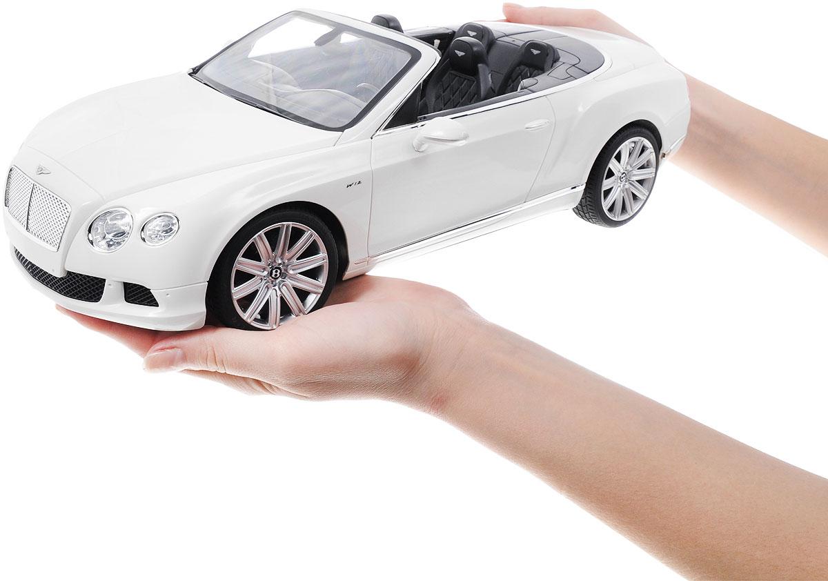 """Радиоуправляемая модель Rastar """"Bentley Continental GT Speed Convertible"""" станет отличным подарком любому мальчику! Все дети хотят иметь в наборе своих игрушек ослепительные, невероятные и крутые автомобили на радиоуправлении. Тем более, если это автомобиль известной марки с проработкой всех деталей, удивляющий приятным качеством и видом. Одной из таких моделей является автомобиль на радиоуправлении Rastar """"Bentley Continetal GT Speed Convertible"""". Это точная копия настоящего авто в масштабе 1:12. Авто обладает неповторимым провокационным стилем и спортивным характером. Потрясающая маневренность, динамика и покладистость - отличительные качества этой модели. Возможные движения: вперед, назад, вправо, влево, остановка. Имеются световые эффекты. Пульт управления работает на частоте 40 MHz. Для работы игрушки необходимы 5 батареек типа АА (не входят в комплект). Для работы пульта управления необходима 1 батарейка напряжением 9V типа 6F22..."""