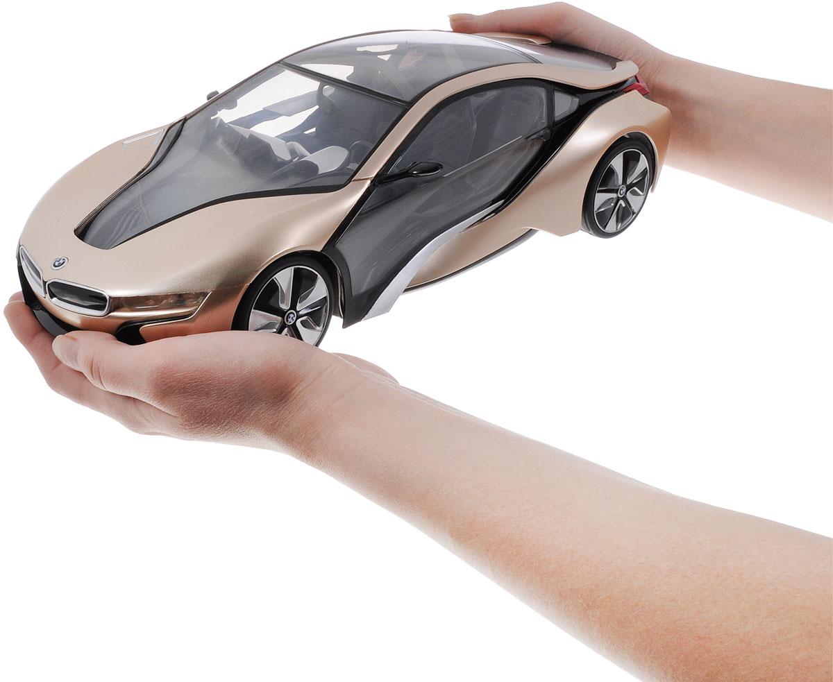 """Радиоуправляемая модель Rastar """"BMW i8"""" станет отличным подарком любому мальчику! Все дети хотят иметь в наборе своих игрушек ослепительные, невероятные и модные автомобили на радиоуправлении. Тем более, если это автомобиль известной марки с проработкой всех деталей, удивляющий приятным качеством и видом. Одной из таких моделей является автомобиль на радиоуправлении Rastar """"BMW i8"""". Это точная копия настоящего авто в масштабе 1:14. Автомобиль обладает неповторимым провокационным стилем и спортивным характером. Потрясающая маневренность, динамика и покладистость - отличительные качества этой модели. Возможные движения: вперед, назад, вправо, влево, остановка. При движении загораются фары и стоп-сигналы. При нажатии на крышу - эффект """"бриллиантового"""" свечения салона автомобиля. Для работы игрушки необходимы 5 батареек типа АА (не входят в комплект). Для работы пульта управления необходима 1 батарейка типа """"Крона"""" (не входит в комплект)."""