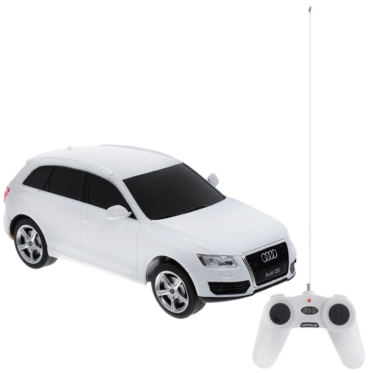 """Радиоуправляемая модель Rastar """"Audi Q5"""" станет отличным подарком любому мальчику! Все дети хотят иметь в наборе своих игрушек ослепительные, невероятные и модные автомобили на радиоуправлении. Тем более, если это автомобиль известной марки с проработкой всех деталей, удивляющий приятным качеством и видом. Одной из таких моделей является автомобиль на радиоуправлении Rastar """"Audi Q5"""". Это точная копия настоящего авто в масштабе 1:24. Автомобиль обладает неповторимым стилем и спортивным характером. Потрясающая маневренность, динамика и покладистость - отличительные качества этой модели. Возможные движения: вперед-назад, вправо-влево, остановка. Пульт управления работает на частоте 40 MHz. Машина работает от 3 батареек типа АА (не входят в комплект). Пульт работает от 2 батареек типа АА (не входят в комплект)."""